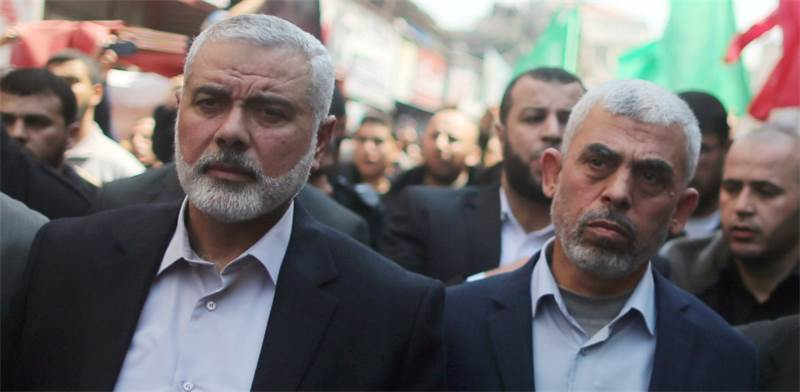 Hamas leaders Ismail Haniyeh and Yahya Sinwar  photo Mohammed Sale, Reuters